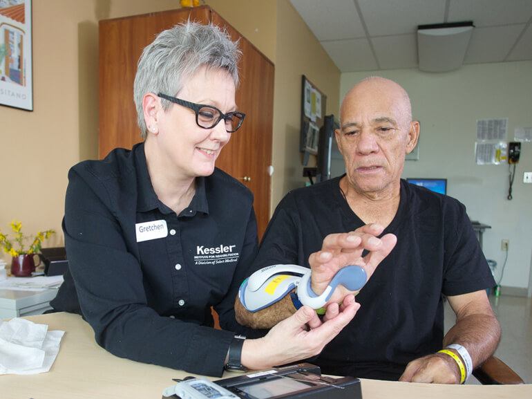 stroke patient working with physical therapist