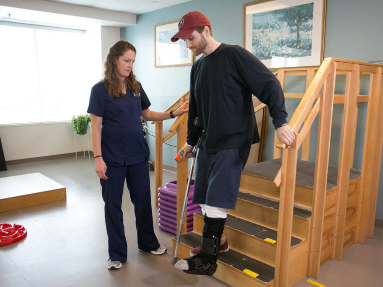 orthopedic patient working with physical therapist